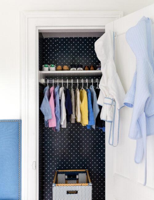 wallpapered closet in nursery design darling