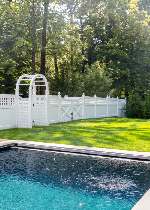 english lattice fence and arbor in design darling backyard