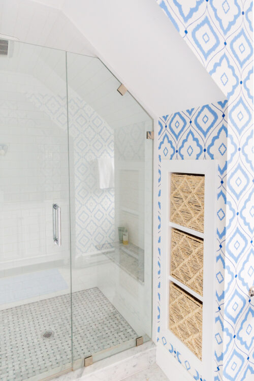 angled walk in shower with bench and built in storage