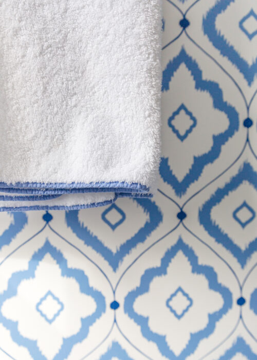 thibaut bungalow blue wallpaper and matouk cairo towel in azure