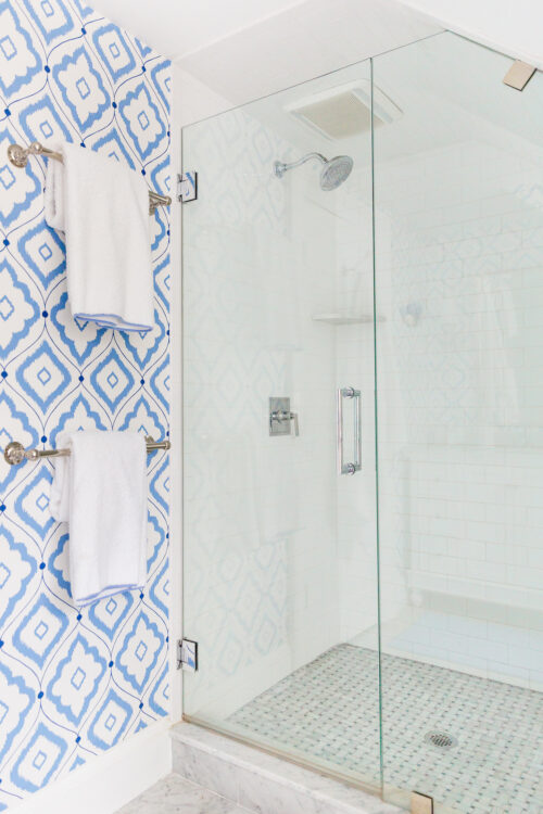 thibaut bungalow blue wallpaper in bathroom with basketweave tile shower